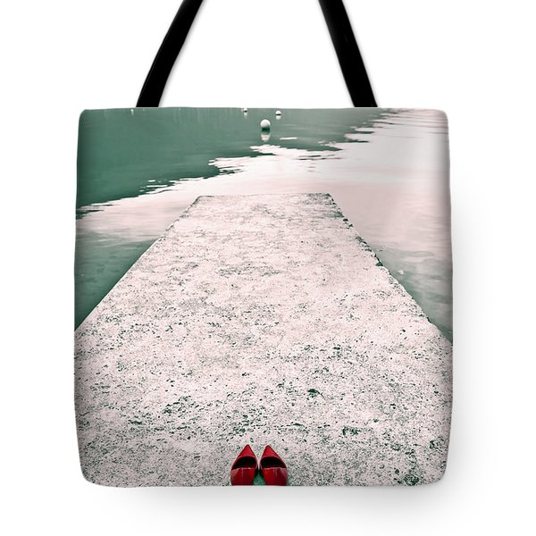 A Pair Of Red Women's Shoes Lying On A Walkway That Leads Into A Tote Bag by Joana Kruse