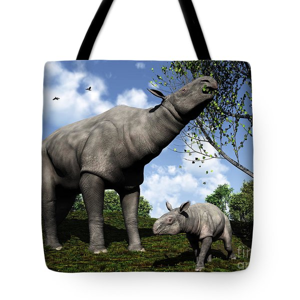 A Paraceratherium Mother Grazes Tote Bag by Walter Myers