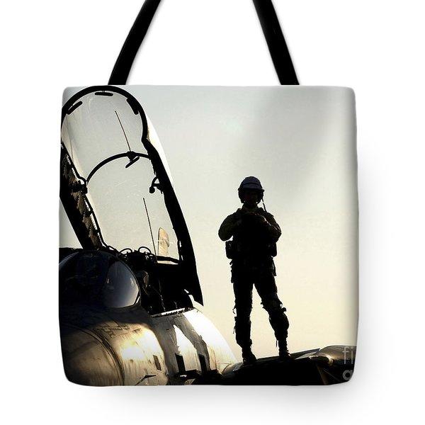 A Pilot Prepares To Enter His F-14b Tote Bag by Stocktrek Images