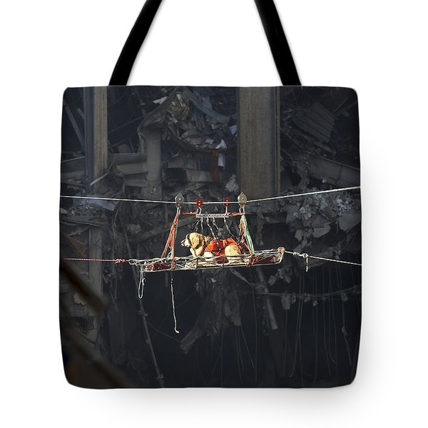 A Rescue Dog Is Transported Tote Bag by Stocktrek Images