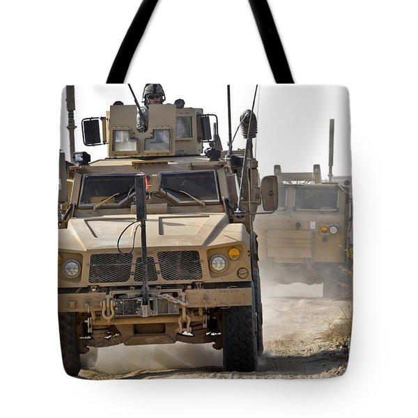 A U.s. Army M-atv Leads A Convoy Tote Bag by Stocktrek Images