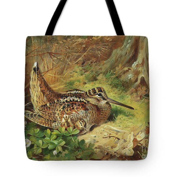 A Woodcock And Chicks Tote Bag by Archibald Thorburn