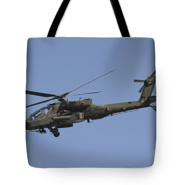 Ah-64 Apache In Flight Over The Baghdad Tote Bag by Terry Moore