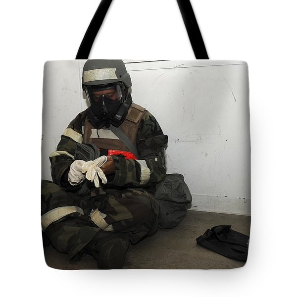 Airman Dons His Chemical Warfare Tote Bag by Stocktrek Images