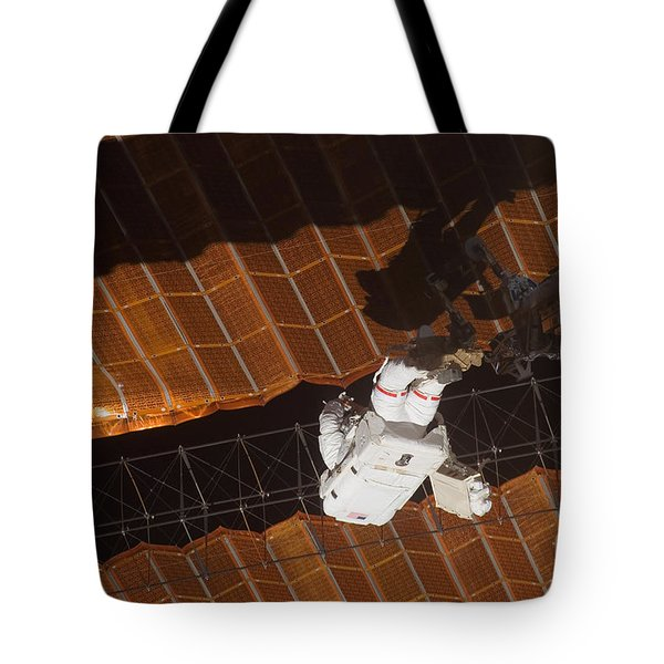An Astronaut Anchored To A Foot Tote Bag by Stocktrek Images