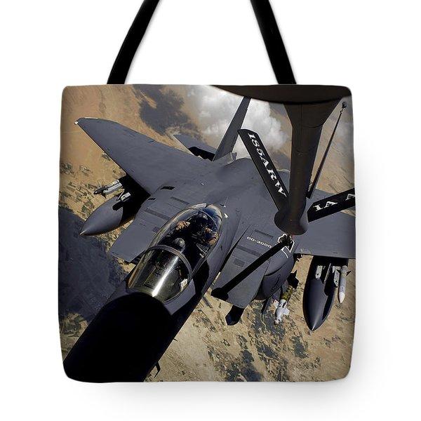 An F-15 Strike Eagle Prepares Tote Bag by Stocktrek Images