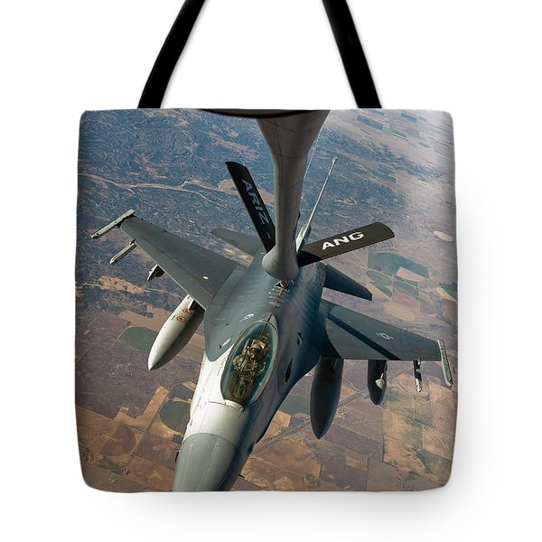 An F-16 Fighting Falcon Receiving Fuel Tote Bag by Stocktrek Images