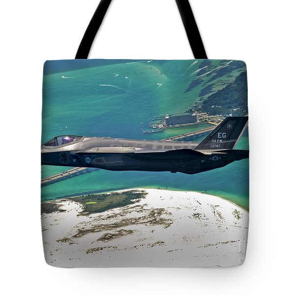 An F-35 Lightning II Flies Over Destin Tote Bag by Stocktrek Images