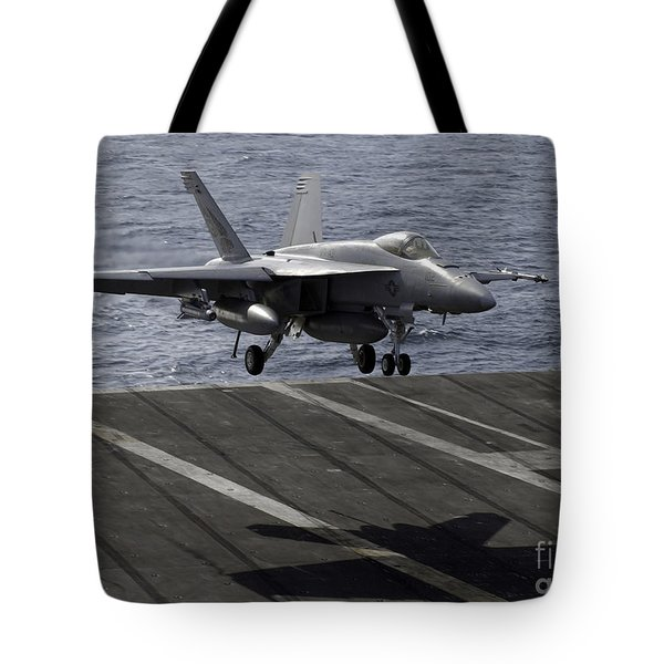 An Fa-18e Super Hornet Prepares To Land Tote Bag by Stocktrek Images