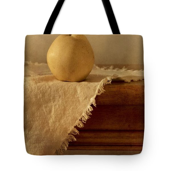 apple pear on a table Tote Bag by Priska Wettstein