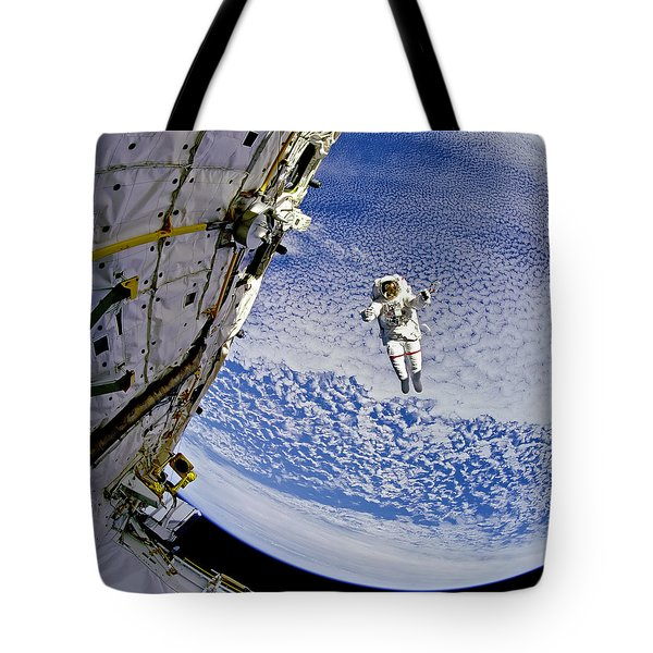Astronaut In Atmosphere Tote Bag by The  Vault - Jennifer Rondinelli Reilly