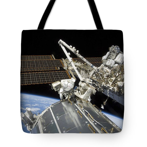 Astronauts Perform A Series Of Tasks Tote Bag by Stocktrek Images
