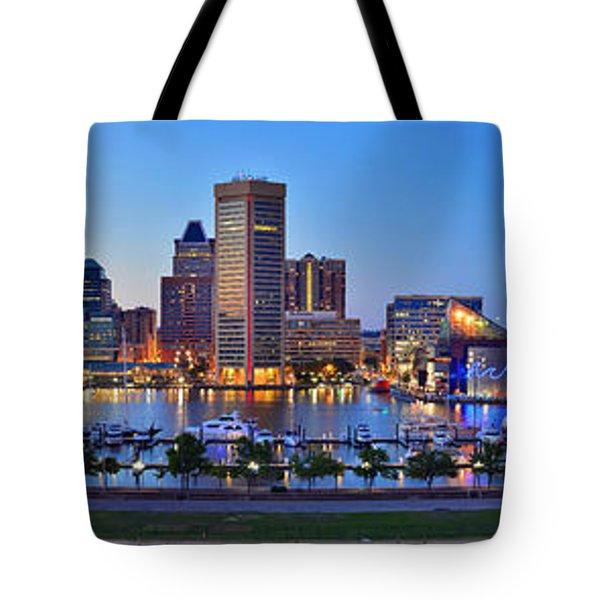 Baltimore Skyline Inner Harbor Panorama At Dusk Tote Bag by Jon Holiday