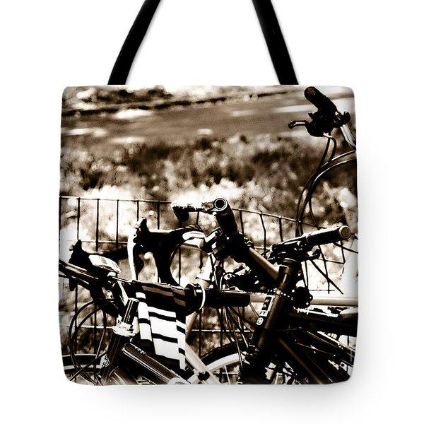 Bike Against The Fence Tote Bag by Madeline Ellis