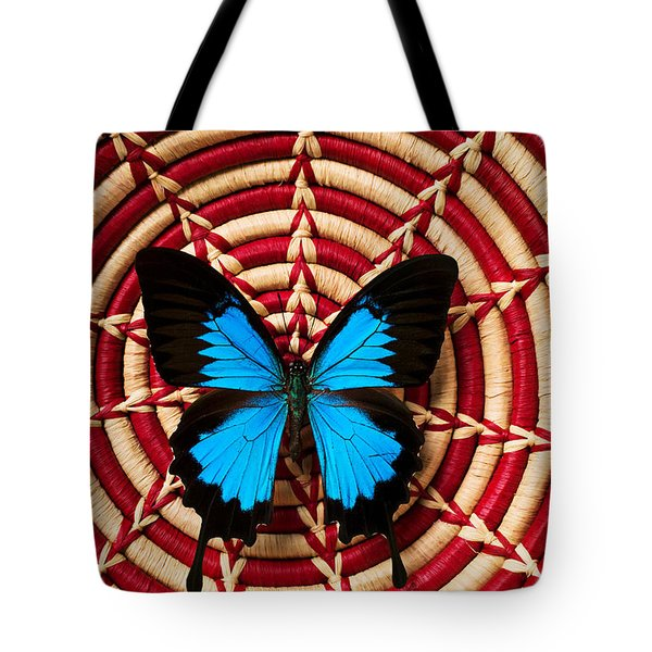 Blue black butterfly in basket Tote Bag by Garry Gay