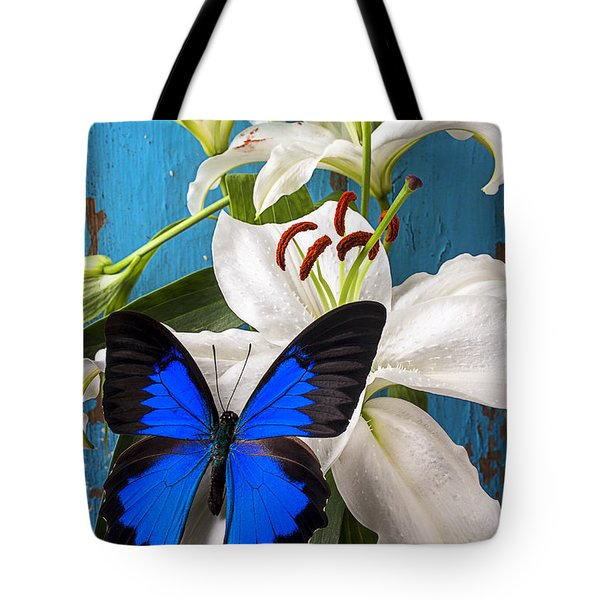 Blue butterfly on white tiger lily Tote Bag by Garry Gay