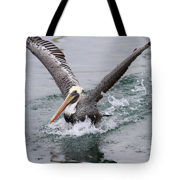 Brown Pelican Landing On Water . 7D8372 Tote Bag by Wingsdomain Art and Photography