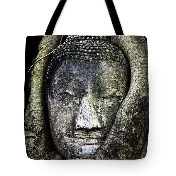 Buddha Head in Banyan Tree Tote Bag by Adrian Evans