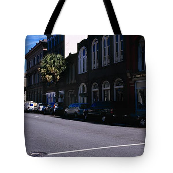 Buildings On Both Sides Of A Road Tote Bag by Panoramic Images