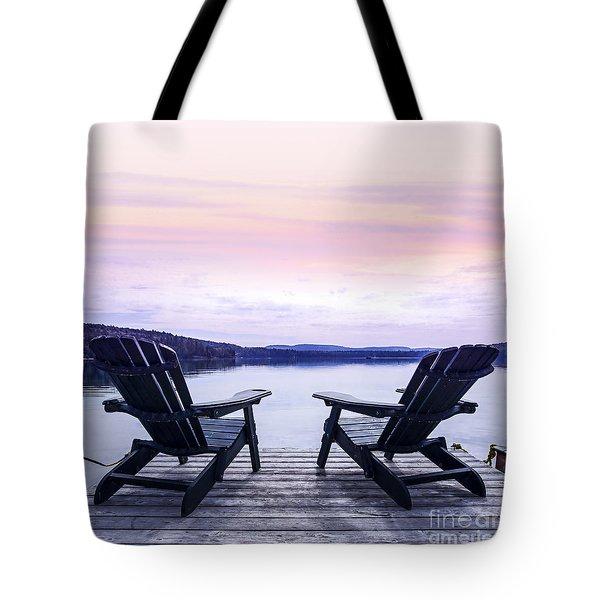 Chairs on lake dock Tote Bag by Elena Elisseeva