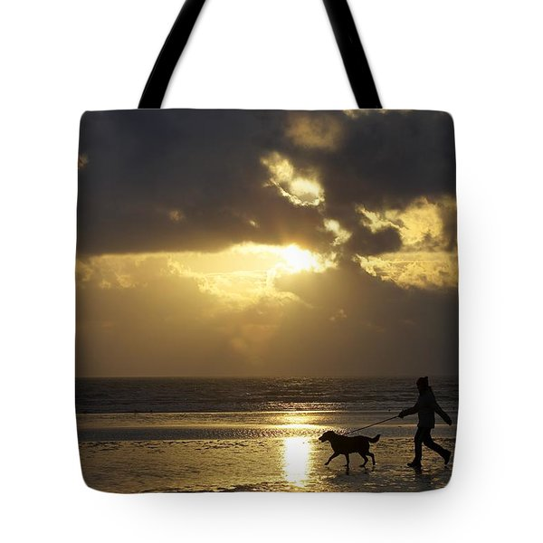 County Meath, Ireland Girl Walking Dog Tote Bag by Peter McCabe