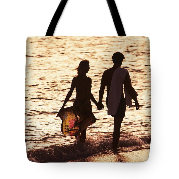 Couple Wading In Ocean Tote Bag by Larry Dale Gordon - Printscapes