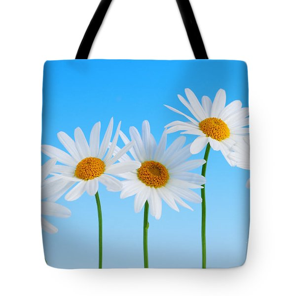 Daisy Flowers On Blue Tote Bag by Elena Elisseeva