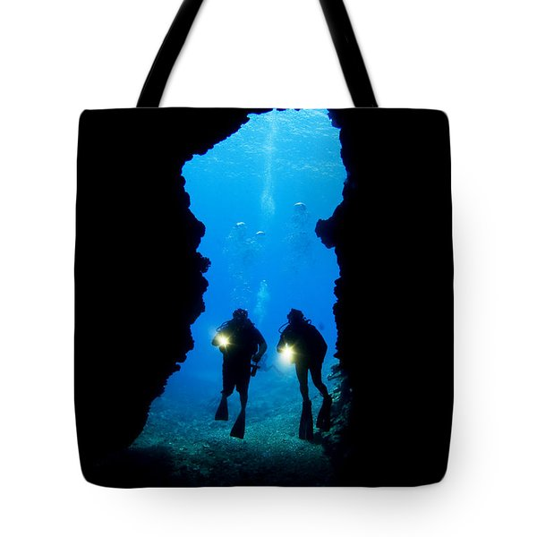 Divers Silhouetted Through Reef Tote Bag by Dave Fleetham - Printscapes