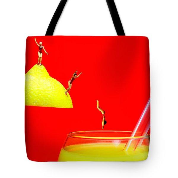 Diving Into Orange Juice Tote Bag by Paul Ge