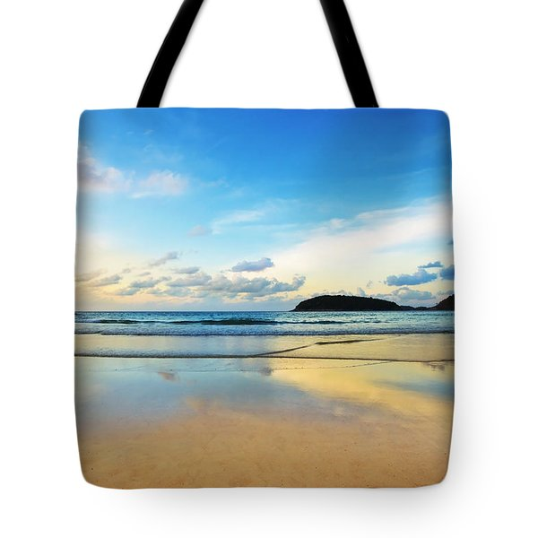 dramatic scene of sunset on the beach Tote Bag by Setsiri Silapasuwanchai