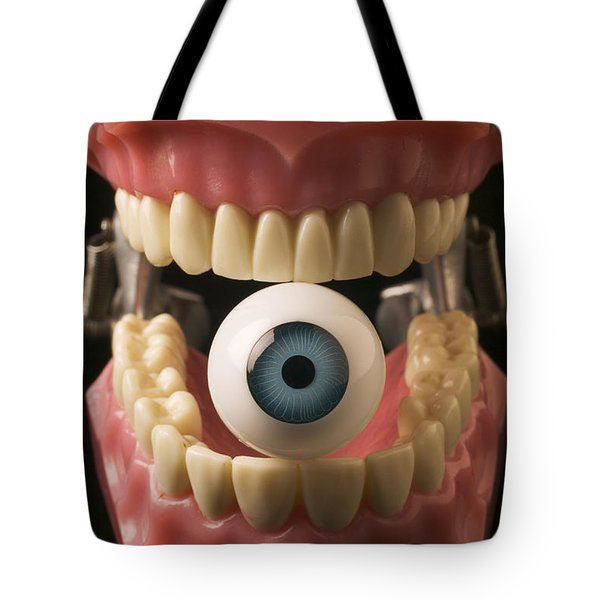 Eye held by teeth Tote Bag by Garry Gay