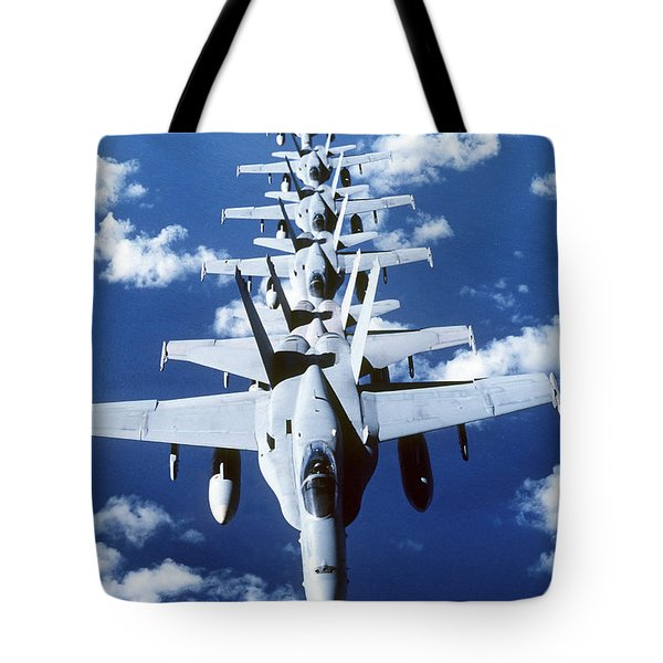 Fa-18c Hornet Aircraft Fly In Formation Tote Bag by Stocktrek Images