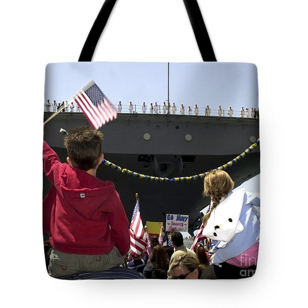 Family And Friends Wait To Welcome Home Tote Bag by Stocktrek Images