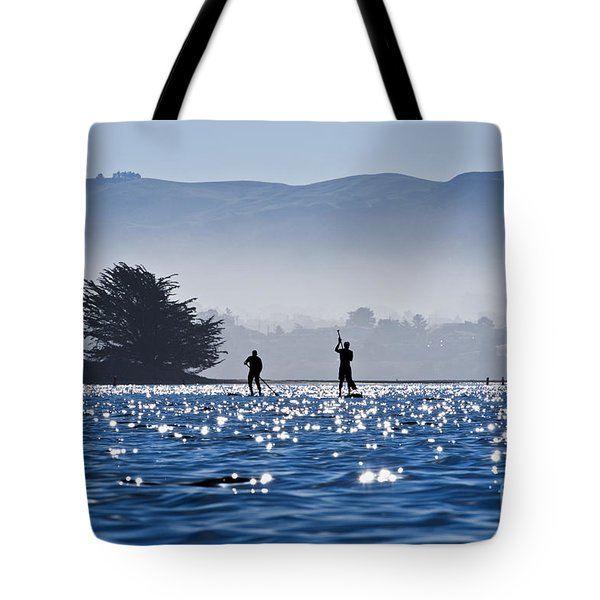 Faraway Paddle Boarders In Morro Bay Tote Bag by Bill Brennan - Printscapes