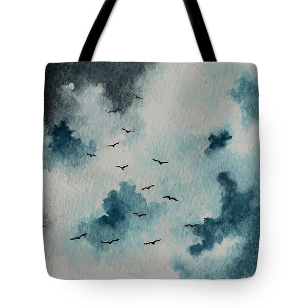 Flock Of Birds Against A Dark Sky  Tote Bag by Michael Vigliotti