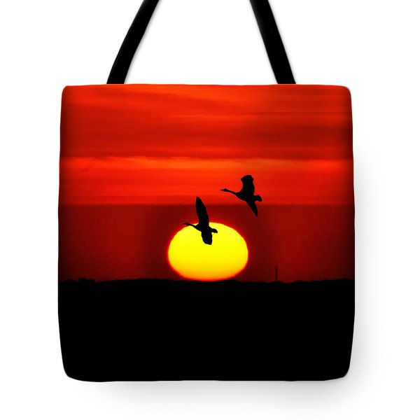 Flying North at Sunrise Tote Bag by Bill Cannon