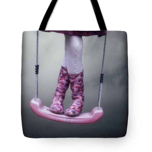 girl swinging Tote Bag by Joana Kruse