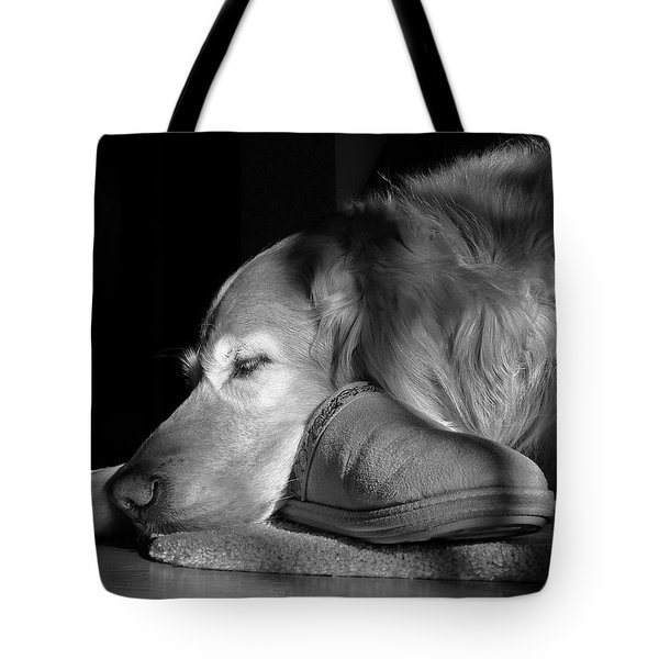 Golden Retriever Dog With Master's Slipper Black And White Tote Bag by Jennie Marie Schell