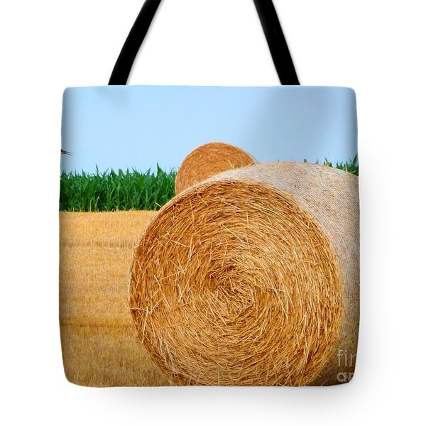 Hay Bale With Crane Tote Bag by Michael Garyet