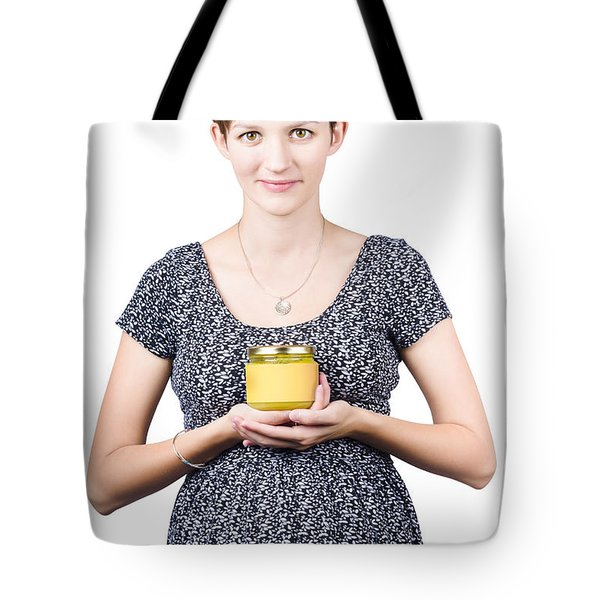 Holistic naturopath holding jar of homemade spread Tote Bag by Ryan Jorgensen