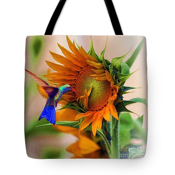 hummingbird on sunflower Tote Bag by John  Kolenberg