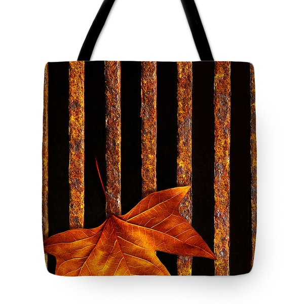 Leaf in drain Tote Bag by Carlos Caetano