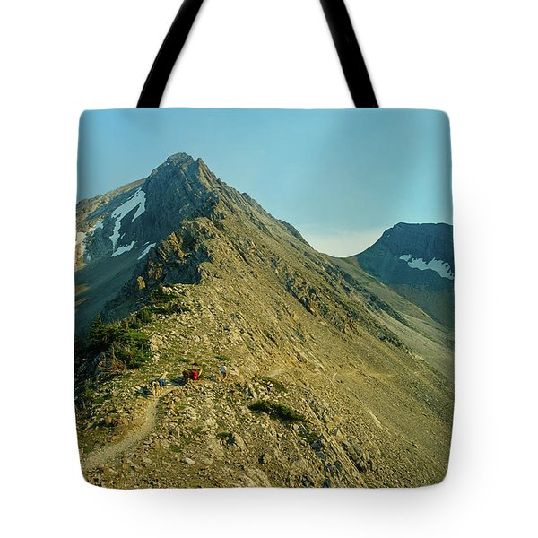 Llama Packer Hiking A Steep Rocky Mountain Peak Trail Tote Bag by Jerry Voss