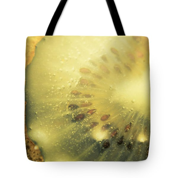 Macro Shot Of Submerged Kiwi Fruit Tote Bag by Jorgo Photography - Wall Art Gallery