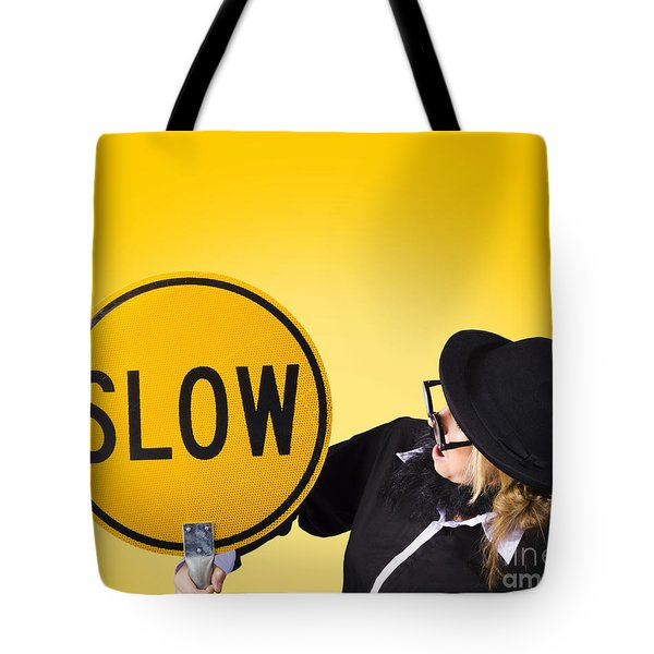 Man Holding Slow Sign During Adverse Conditions Tote Bag by Ryan Jorgensen