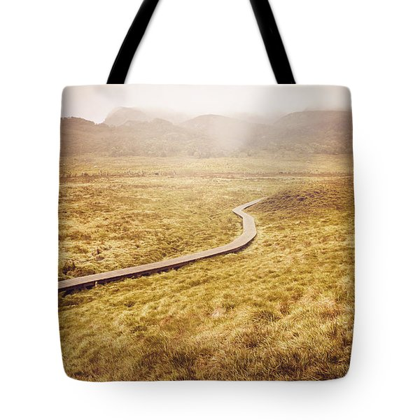Man on expedition along Cradle Mountain Boardwalk Tote Bag by Ryan Jorgensen