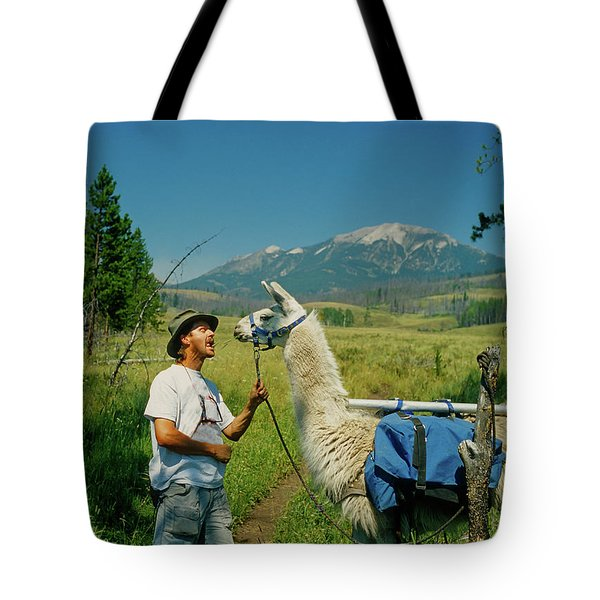 Man Teasing A Llama Tote Bag by Jerry Voss