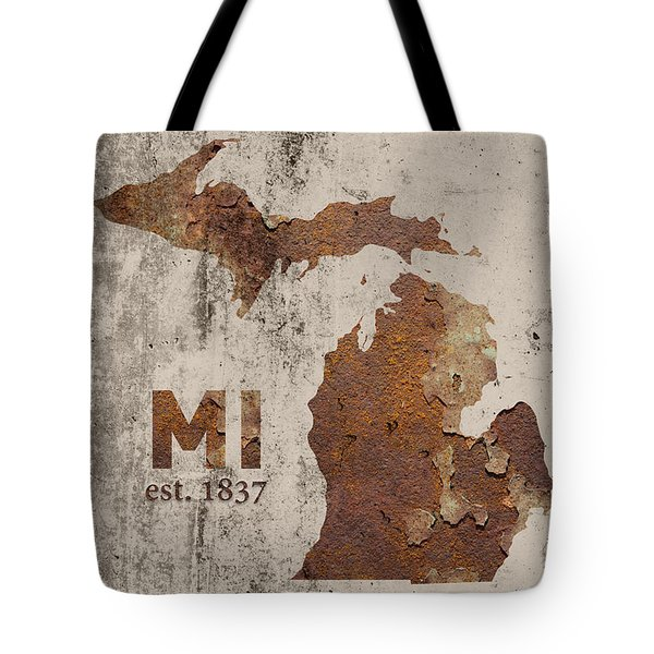 Michigan State Map Industrial Rusted Metal On Cement Wall With Founding Date Series 005 Tote Bag by Design Turnpike