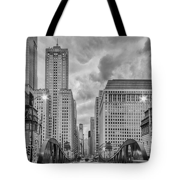 Monochrome Image Of The Marshall Suloway And Lasalle Street Canyon Over Chicago River - Illinois Tote Bag by Silvio Ligutti