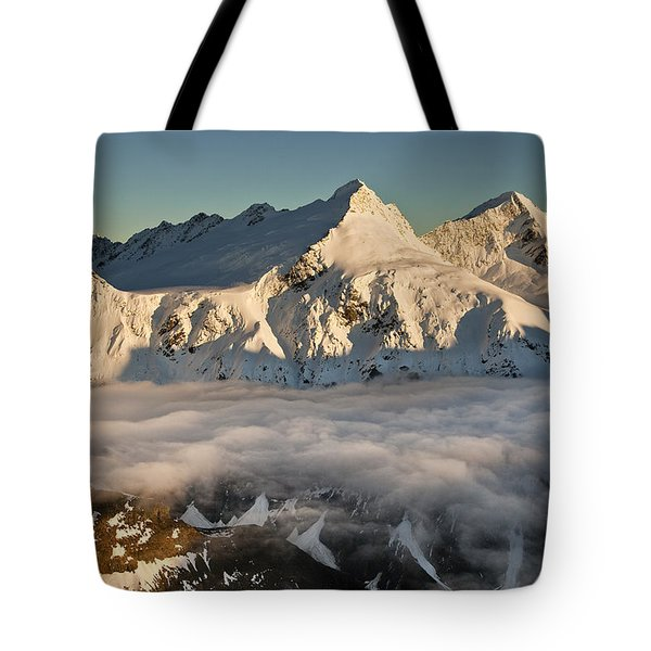 Mount Pollux And Mount Castor At Dawn Tote Bag by Colin Monteath
